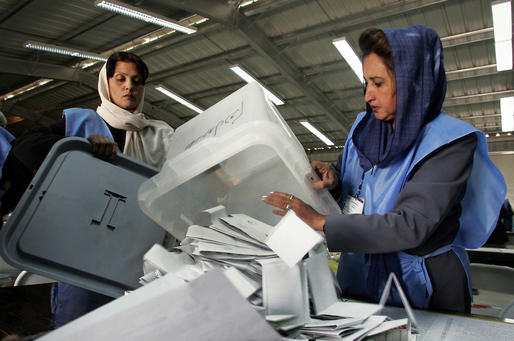 Ballot papers arrive at counting center.&amp;#xD;&amp;#xA;11th October 2004,&amp;#xD;&amp;#xA;Kabul, Afghanistan.&amp;#xD;&amp;#xA;Ballot papers arrive at counting center.&amp;#xD;&amp;#xA;&amp;#xD;&amp;#xA;The sorting and counting of ballot papers in Afghanistans controversial Presidential elections got under way as ballot boxes arrived by helicopter from the provinces. Men and women tipped and sorted the contents of the boxes in a large warehouse on a miliatry base in Kabul.&amp;#xD;&amp;#xA;<br />