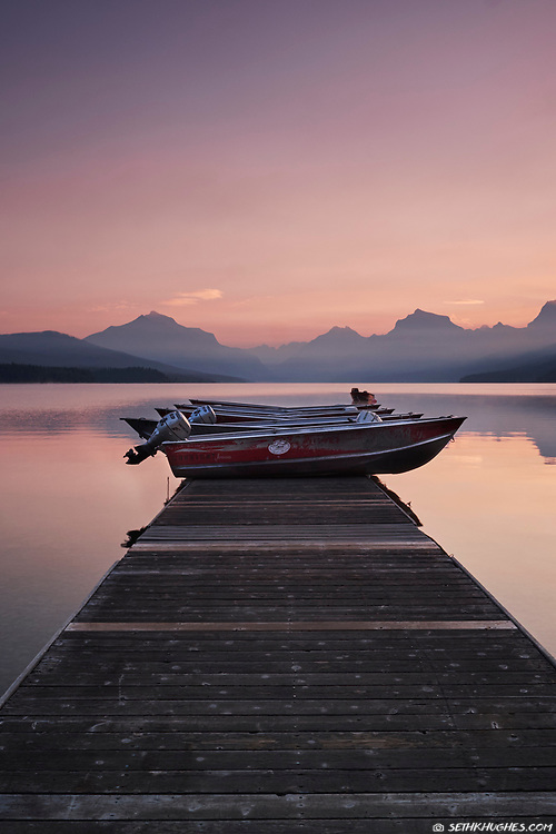 Boats for rent at dawn on the dock at Lake McDonald, Glacier National Park, Montana.