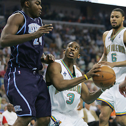 New Orleans Hornets guard Chris Paul #3 drives in against Paul Millsap #24 of the Utah Jazz in the second quarter of their NBA game on April 8, 2008 at the New Orleans Arena in New Orleans, Louisiana.