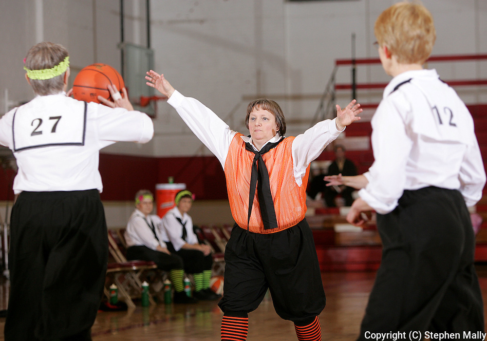 Cedar Rapids Sizzlers' Charlotte Emerson (left), age 63, tries to pass over Robins Late Bloomer's Pat Oliver (center), age 56, as teammate Diana Murker (right), age 56, looks on during their game at Coe College on February 14, 2007.