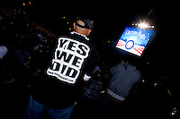Barack Obama supporters watch poll numbers being announced as supporters take to Chicago's Grant Park for the election night results for the presidential race between Sen. Barak Obama (D-IL) and Sen. John McCain (R-AZ) Tuesday Nov. 4, 2008 Chicago IL.