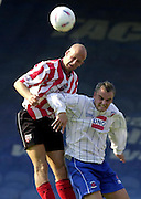 Nationwide Div 2 - Brentford v Hartlepool..Brentford's [left] Eddie Hutchinson redirect the ball - challenged by Hartlepool's Mark Tinkler © Peter Spurrier/Intersport-Images, email images@intersport-images.com. Mob +447973819551