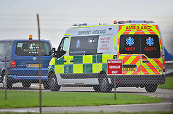 © Licensed to London News Pictures. 30/10/2015. London, UK. Am ambulance waiting ascA plane carrying former Guantanamo Bay detainee, Shaker Aamer arriving at Biggin Hill airport's  Photo credit: Ben Cawthra/LNP