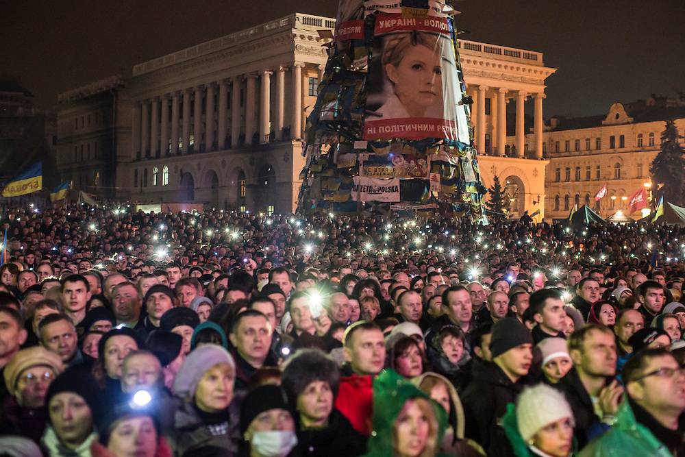 KIEV, UKRAINE - FEBRUARY 22: A large photograph of former Prime Minister Yulia Tymoshenko hangs on the side of a structure on Independence Square before her address to anti-government protesters gathered there on February 22, 2014 in Kiev, Ukraine. The leader of the 2004 Orange Revolution against current embattled President Viktor Yanukovych traveled to Kiev to address the crowd immediately after being released from prison on what many claim were politically motivated charges. (Photo by Brendan Hoffman/Getty Images) *** Local Caption ***