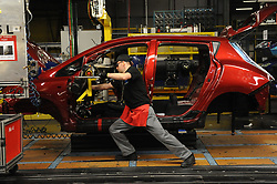Embargoed to 0001 Thursday June 29 File photo dated 28/03/13 of a dashboard being fitted on a car manufacturing line. Production of new cars fell by almost 10\% last month compared with a year ago, new figures show.