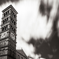 Clouds rush across the sky above the St Andrews Church bell tower. The Romanesque tower and its church, built in the 1902s, are well-known landmarks in Old Pasadena, CA.