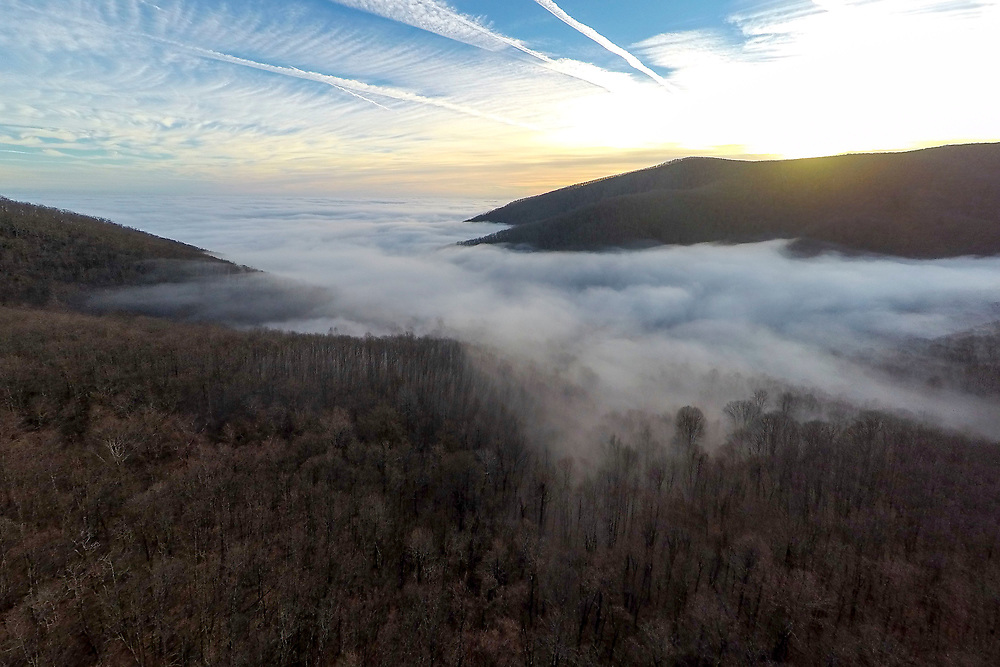 BIG ISLAND, VA - JAN 20: Clouds fill the valley of the Blue Ridge Mountains as the sun sets, pictured on Friday, Jan. 20, 2017 near Big Island, Va.