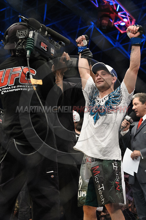 """ABU DHABI, UNITED ARAB EMIRATES, APRIL 10, 2010: Frankie Edgarcelebrates as he is declared the winner of his fight at """"UFC 112: Invincible"""" inside Ferari World, Abu Dhabi on April 10, 2010"""