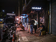 28 JANUARY 2016 - BANGKOK, THAILAND:  People walk into SoulBar, a popular bar on Chareon Krung Road in the Chinatown section of Bangkok.       PHOTO BY JACK KURTZ