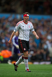 BIRMINGHAM, ENGLAND - Sunday, May 22, 2011: Liverpool's Jamie Carragher, wearing a head bandage, in action against Aston Villa during the Premiership match at Villa Park. (Photo by David Rawcliffe/Propaganda)