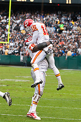 November 7, 2010; Oakland, CA, USA;  Kansas City Chiefs wide receiver Verran Tucker (15) celebrates with offensive tackle Branden Albert (76) after scoring a touchdown against the Oakland Raiders during the second quarter at Oakland-Alameda County Coliseum.