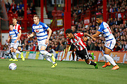 Brentford Defender Rico Henry (3) gets fouled during the EFL Sky Bet Championship match between Brentford and Reading at Griffin Park, London, England on 16 September 2017. Photo by Andy Walter.