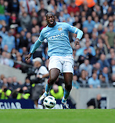 Yaya Toure in action during the Barclays Premier League match between Manchester City and Chelsea at the City of Manchester Stadium on September 25, 2010 in Manchester, England.
