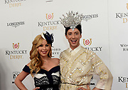 Tara Lipinski and Johnny Weir, American Olympic figure skaters and TV commentators, walk the Kentucky Derby red carpet, Saturday, May 5, 2018, at Churchill Downs in Louisville, Ky.  Longines, the Swiss watch manufacturer known for its luxury timepieces, is the Official Watch and Timekeeper of the 144th annual Kentucky Derby. (Photo by Diane Bondareff/Invision for Longines/AP Images)