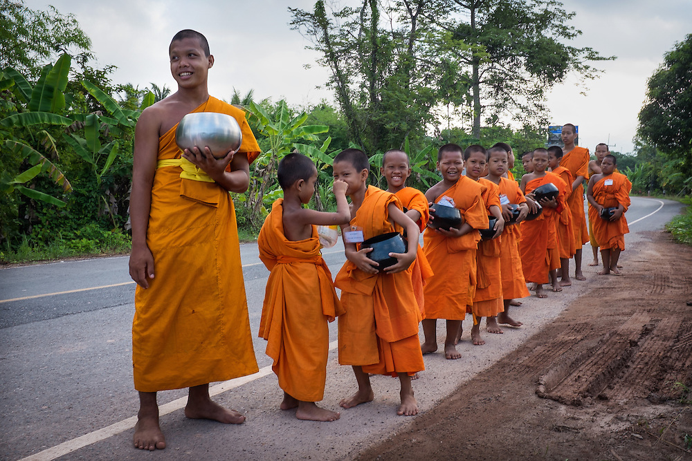 Young men walk for alms for the first time in Ban Na, Nakhon Nayok, Thailand