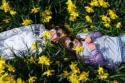 © Licensed to London News Pictures. 03/04/2016. London, UK. Olivia George and Giverny George enjoying sunshine and warm weather in Green Park, London on Sunday, 3 April 2016. Photo credit: Tolga Akmen/LNP