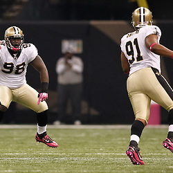 October 3, 2010; New Orleans, LA, USA; New Orleans Saints defensive tackle Sedrick Ellis (98) celebrates after a sack against the Carolina Panthers during the first quarter at the Louisiana Superdome. Mandatory Credit: Derick E. Hingle