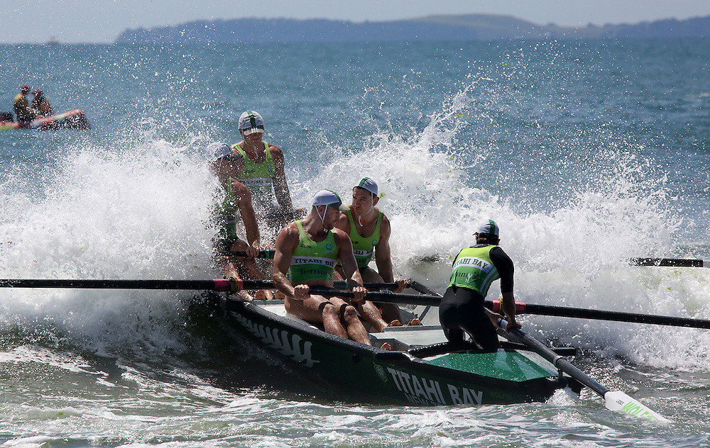 A Titahi Bay surfboat team gets a soaking while pushing out through the breakers at the Eastern Region Championships at Mount Maunganui, Tauranga, New Zealand, Saturday, January 30, 2016. Credit:SNPA / Richard Moore