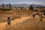 A man rides his bicycle to visit the Mercy Medical Team as they treat patients Saturday, Oct. 18, 2014, at a Fiangonana Loterana Malagasy (FLM) Lutheran church in Antsoantany, Madagascar. LCMS Communications/Erik M. Lunsford