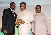Dr Kandeh Yumkella, Director General of the United Nations Industrial Development Organisation. (UNIDO) presenting an international award to  Dr Veerendra Heggade and Dr Manjunath of SKDRDP. The 2012 Ashden Awards for sustainable energy ceremony at the Royal Geographical Society. London.