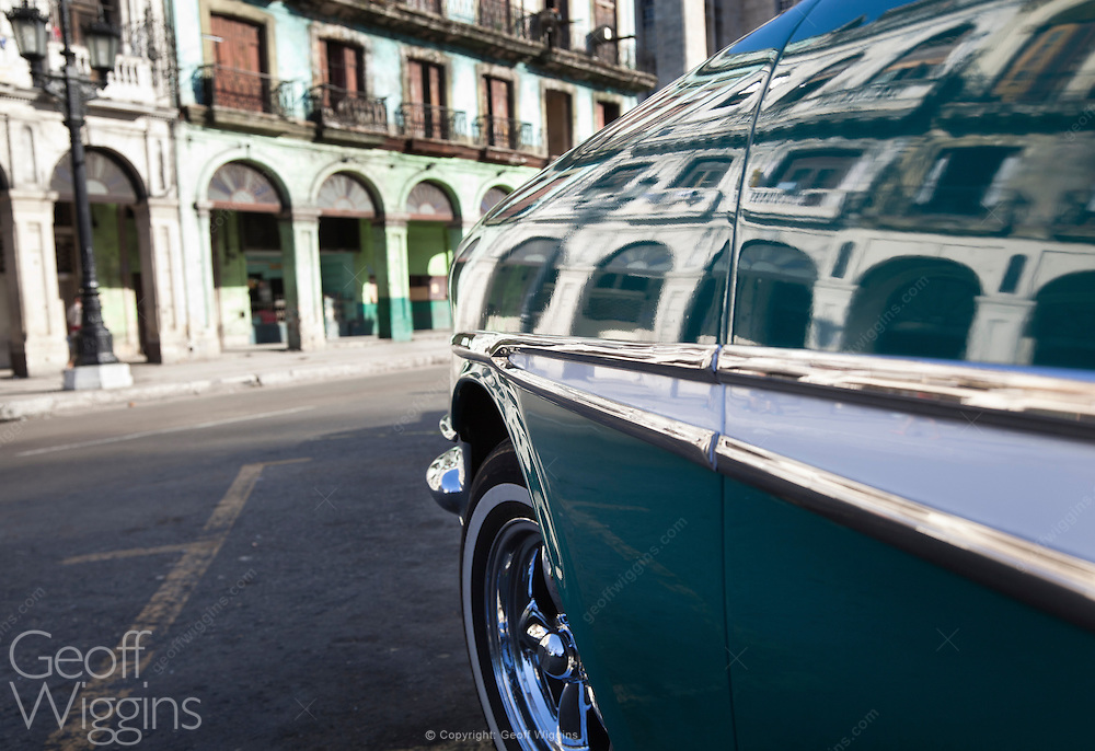 Paseo de Marti, Havana, reflected on a 1957 vintage Pontiac Star Chief, one of an estimated 60,000 Detroit products from the pre-embargo age still surviving in Cuba