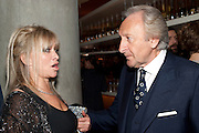 JO WOOD; HAROLD TILLMAN, VOGUE.COM'S 15TH BIRTHDAY. W Hotel, Leicester Sq. London. 17 February 2011. -DO NOT ARCHIVE-© Copyright Photograph by Dafydd Jones. 248 Clapham Rd. London SW9 0PZ. Tel 0207 820 0771. www.dafjones.com.