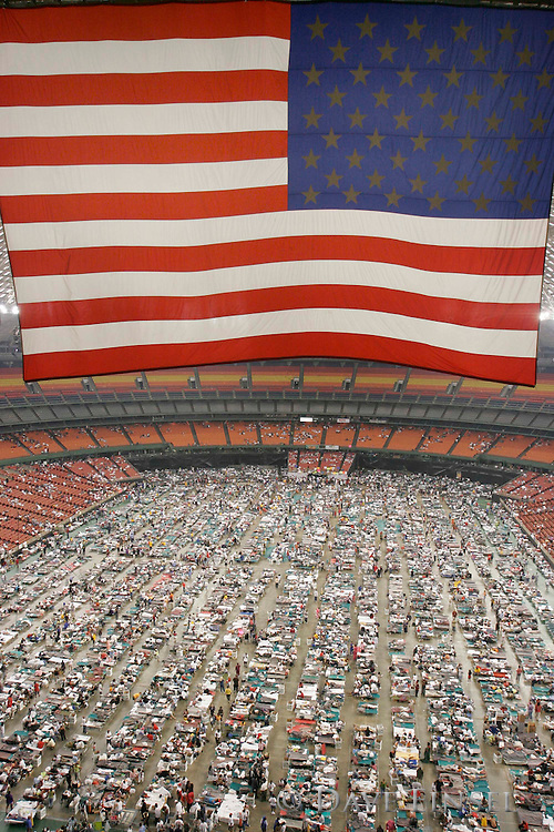 HOUSTON - September 2:  Refugees crowd the floor of the Reliant Astrodome, Friday, Sept. 2, 2005. The facility is currently home to 15,000 evacuees from the south Louisiana area.<br />