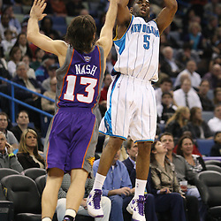 Feb 01, 2010; New Orleans, LA, USA; New Orleans Hornets guard Marcus Thornton (5) shoots over Phoenix Suns guard Steve Nash (13) during the second half at the New Orleans Arena. Mandatory Credit: Derick E. Hingle-US PRESSWIRE