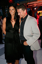 MONTE-CARLO, MONACO - Friday, May 22, 2009: David Couthard with his fiance?e Karen Minier arrive at the Hugo Boss party during the Monaco Formula One Grand Prix at the Monte-Carlo Circuit. (Pic by Juergen Tap/Hoch Zwei/Propaganda)
