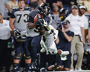 WEST LAFAYETTE, IN - SEPTEMBER 15: Terry Wright #9 of the Purdue Boilermakers makes a catch as Adam Sparks #14 of the Missouri Tigers tackles from behind during the third quarter at Ross-Ade Stadium on September 15, 2018 in West Lafayette, Indiana. (Photo by Michael Hickey/Getty Images) *** Local Caption *** Terry Wright; Adam Sparks NCAA Football - Purdue Boilermakers vs Missouri Tigers at Ross-Ade Stadium in West Lafayette, Indiana. Sports photographer by Michael Hickey
