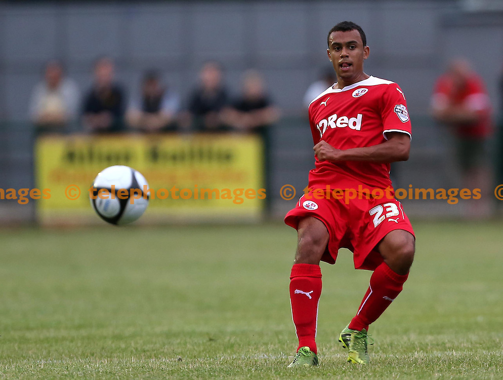 Crawley&rsquo;s Ryan Richefond passes the ball up field during the pre season friendly between Three Bridges and Crawley Town at Jubilee Field in Crawley. July 28, 2014.<br /> James Boardman TELEPHOTO IMAGES