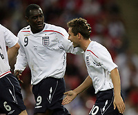 Photo: Rich Eaton.<br /> <br /> England v Russia. UEFA European Championships Qualifying. 12/09/2007. England's Emile Heskey (L) congratulates Michael Owen (R) on his second goal.