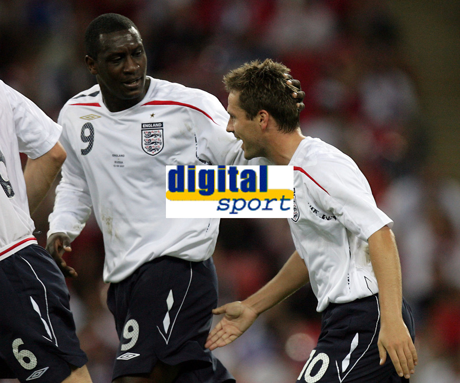 Photo: Rich Eaton.<br /> <br /> England v Russia. UEFA European Championships Qualifying. 12/09/2007. England's Emile Heskey (L) congratulates Michael Owen (R) on his second goal.