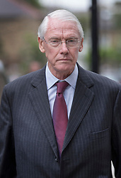 © Licensed to London News Pictures. 29/06/2017. London, UK. Retired Court of Appeal judge Sir Martin Moore-Bick leaves St Clements Church after meeting with Grenfell fire survivors. He has been chosen to lead the public inquiry into the Grenfell Tower fire. Photo credit: Peter Macdiarmid/LNP