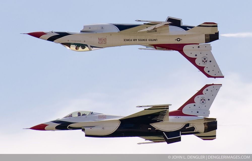 """Two Lockheed Martin F-16 """"Fighting Falcon"""" jets from the United States Air Force Demonstration Squadron–better known as the """"Thunderbirds"""" demonstrate the precision flying for which they are known during the air show at the new Branson Airport, in Branson, Mo. The The Branson Airport, is the first privately financed and operated commercial service airport in the United States."""