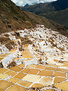 High-angle view of Salinas de Maras (Maras Saltworks), near Cusco, Peru, with Mount Veronica in the background.