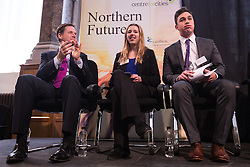 © Licensed to London News Pictures . 06/11/2014 . Leeds , UK . The Deputy Prime Minister Nick Clegg (left) applauds Year 13 students Freya Tweedy (centre) and Sam Simkins (right) of Abbey Grange Academy in Leeds , after they addressed the Northern Futures Summit in Leeds this morning (Thursday 6th November 2014) .  . Photo credit : Joel Goodman/LNP