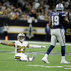 Sep 29, 2019; New Orleans, LA, USA; New Orleans Saints cornerback Marshon Lattimore (23) signals incomplete after breaking up a pass to Dallas Cowboys wide receiver Amari Cooper (19) during the first quarter at the Mercedes-Benz Superdome. Mandatory Credit: Derick E. Hingle-USA TODAY Sports