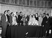 "27/05/1959<br /> 05/27/1959<br /> 27 May 1959<br /> Presentation of Esso Perpetual Trophy to the Listowel Drama Group at the Shelbourne Hotel, Dublin. The trophy and replicas for the  All Ireland Amateur Dram festival were presented by Mr. T.F. Laurie, Chairman and Managing Director of Esso Petroleum Co. (Ireland) Ltd. at a special luncheon. The Listowel group won the competition with their performance of the 3 Act play ""Sive"" by John B. Keane. Picture shows Mr Laurie (7th from right) presenting the trophy to Mr Bryan McMahon, President Listowel Drama Group. Also in the picture are the cast (l-r): William Kearney; Kevin O'Donovan;  Brian Brennan; Siobhan Cahill; Brendan Carroll (Producer); Bryan McMahon; T.F. Laurie; Mrs D.J. Moloney, Chairman Listowel Drama Group; Margaret Dillon; Nora Relihan; Hilery Neilson; John Flaherty and Sean Cahill."