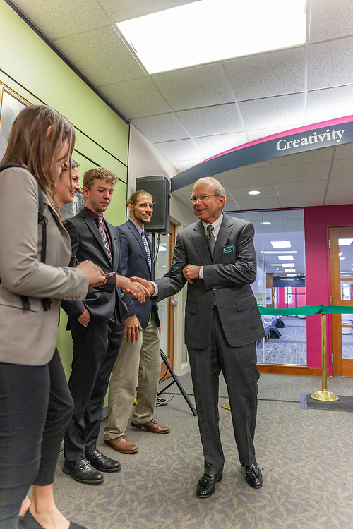 David Pidwell, national trustee,  greets Winter Wilson, a university innovation fellow and a junior in environmental studies and journalism, before the grand opening and ribbon cutting for the new CoLab, October 18, 2018. (Photo by Stephen Zenner/Ohio University Libraries)