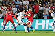 England Forward Wayne Rooney battles with Slovakia Defender Milan Škriniar during the Euro 2016 Group B match between Slovakia and England at Stade Geoffroy Guichard, Saint-Etienne, France on 20 June 2016. Photo by Phil Duncan.