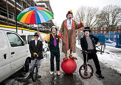 © licensed to London News Pictures. London, UK 05/02/12. Clowns posing before the annual clown service in memory of Grimaldi at the Holy Trinity Church in Dalston, London. Photo credit: Tolga Akmen/LNP