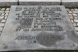 A memorial plaque at the Auschwitz-Birkenau Nazi concentration camps in Auschwitz, Poland on September 3, 2017. Auschwitz concentration camp was a network of German Nazi concentration camps and extermination camps built and operated by the Third Reich in Polish areas annexed by Nazi Germany during WWII. It consisted of Auschwitz I (the original camp), Auschwitz II–Birkenau (a combination concentration/extermination camp), Auschwitz II–Monowitz (a labor camp to staff an IG Farben factory), and 45 satellite camps. In September 1941, Auschwitz II–Birkenau went on to become a major site of the Nazi Final Solution to the Jewish Question. From early 1942 until late 1944, transport trains delivered Jews to the camp's gas chambers from all over German-occupied Europe, where they were killed en masse with the pesticide Zyklon B. An estimated 1.3 million people were sent to the camp, of whom at least 1.1 million died. Around 90 percent of those killed were Jewish; approximately 1 in 6 Jews killed in the Holocaust died at the camp. Others deported to Auschwitz included 150,000 Poles, 23,000 Romani and Sinti, 15,000 Soviet prisoners of war, 400 Jehovah's Witnesses, and tens of thousands of others of diverse nationalities, including an unknown number of homosexuals. Many of those not killed in the gas chambers died of starvation, forced labor, infectious diseases, individual executions, and medical experiments. In 1947, Poland founded a museum on the site of Auschwitz I and II, and in 1979, it was named a UNESCO World Heritage Site. Photo by Somer/ABACAPRESS.COM