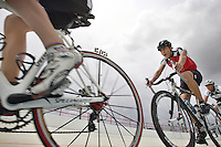 Daniel Jimenez, 17, center, and Carlos Rocha, 17, are riding their bicycles at the Bryan Piccolo park's velodrome on Monday June 29, 2009. Staff photo/Cristobal Herrera.