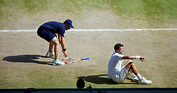 LONDON, ENGLAND - Friday, July 4, 2014: Grigor Dimitrov (BUL) falls during the Gentlemen's Singles Semi-Final match on day eleven of the Wimbledon Lawn Tennis Championships at the All England Lawn Tennis and Croquet Club. (Pic by David Rawcliffe/Propaganda)