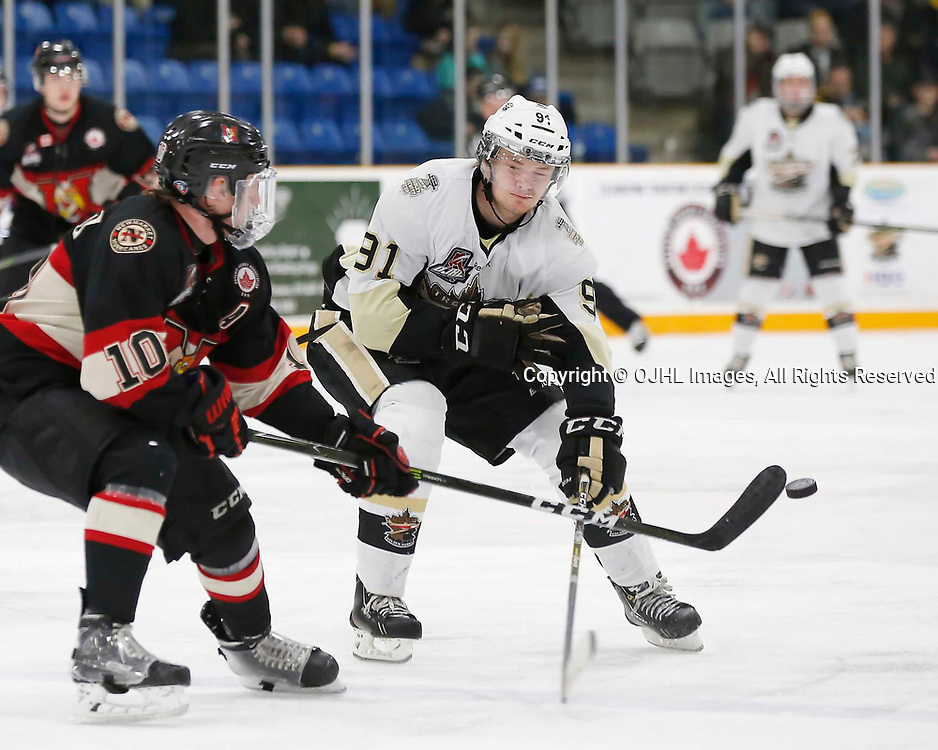 TRENTON, ON - MAR 7,  2017: Ontario Junior Hockey League, playoff game between the Trenton Golden Hawks and the Newmarket Hurricanes., Mac Lewis #91 of the Trenton Golden Hawks tries to stop the pass from Christian Dedonato #10 of the Newmarket Hurricanes<br /> (Photo by Amy Deroche / OJHL Images)