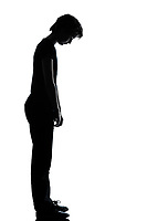 one caucasian young teenager silhouette boy or girl sad looking down  full length in studio cut out isolated on white background