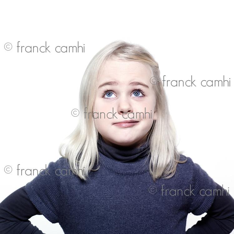 studio portrait of a caucasian cute sulk little girl
