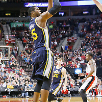 06 December 2013: Utah Jazz power forward Derrick Favors (15) takes a jumpshot during the Portland Trail Blazers 130-98 victory over the Utah Jazz at the Moda Center, Portland, Oregon, USA.