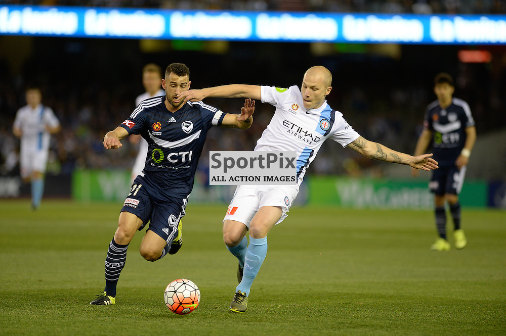 "Carl Valeri (c) of Melbourne Victory, Aaron Mooy of Melbourne City - Hyundai A-League - October 17th 2015 - ROUND 2- Melbourne Victory FC v Melbourne City FC in the first derby for the 2015 season with a 3:2 win to Victory on the 90"" - © Mark Avellino 